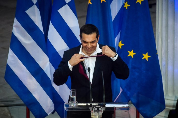 Greek Prime Minister Alexis Tsipras, removes his tie as he speaks at the parliamentary group of Syriza and Independent Greeks in Athens. Reuters photo