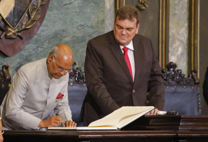 India's President Ram Nath Kovind signs the visitors' book Havana University President Gustavo Cobreiro Suarez watches, in Havana, Cuba, Friday, June 22, 2018. Kovind is on a two-day official visit to Cuba. (AP/PTI photo)