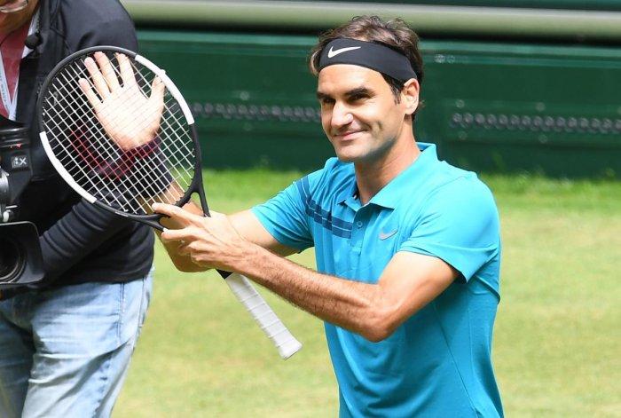 Roger Federer of Switzerland celebrates after defeating US' Denis Kudla in the Halle Open semifinal on Saturday. AFP