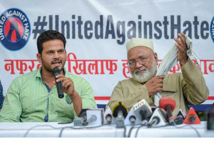 Nasim (L) brother of Md Kasim (45) who was lynched in Hapur allegedly over cow slaughter, speaks during a press conference, at Press Club in New Delhi on Friday, June 22, 2018. Meheruddin (R) brother of Samayuddin is also seen. PTI Photo