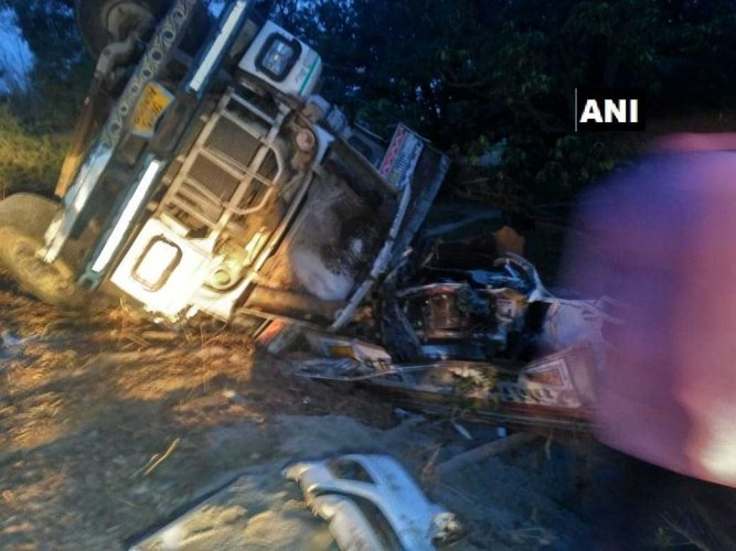 The car was on its way to Bangarmau last night when the truck driver, coming from the opposite direction, lost control over the vehicle following which it overturned. (ANI/Twitter)