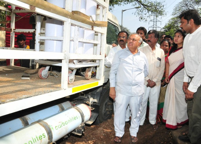 A DH file photo of former minister Ramalinga Reddy inaugurating a waste-to-energy plant in Koramangala.