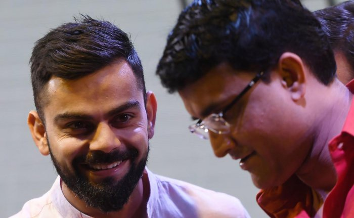 Former India skipper Sourav Ganguly (right) says he is happy Virat Kohli didn't play in county cricket ahead of the five-Test series. AFP