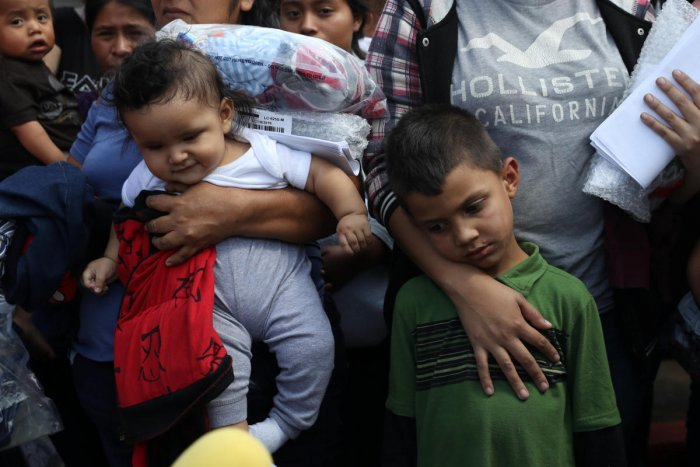 Children of undocumented immigrant families react as they are released from detention at a bus depot in McAllen, Texas. (Reuters Photo)