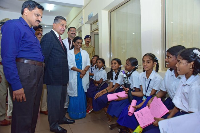 Lokayukta Justice P Vishwanath Shetty speaks to children who had come for treatment at the District Wenlock Hospital in Mangaluru on Friday.