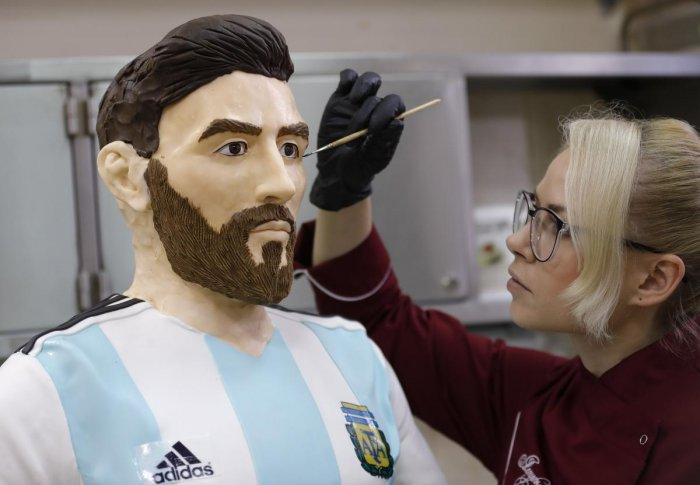 An employee of Altufyevo Confectionery finishes the preparation of a life-size chocolate sculpture of Argentine soccer player Lionel Messi. REUTERS