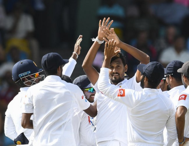 Sri Lanka's stand-in skipper Suranga Lakmal (centre) celebrates with team-mates the dismissal of Devon Smith of West Indies on Saturday. AFP