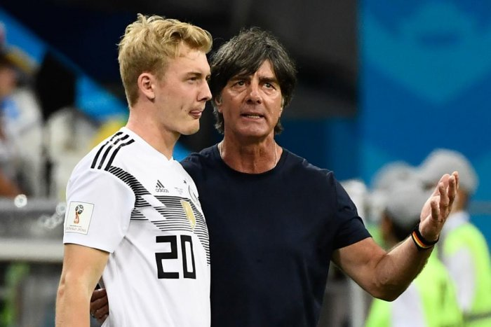 Germany's coach Joachim Loew (right) with forward Julian Brandt. AFP