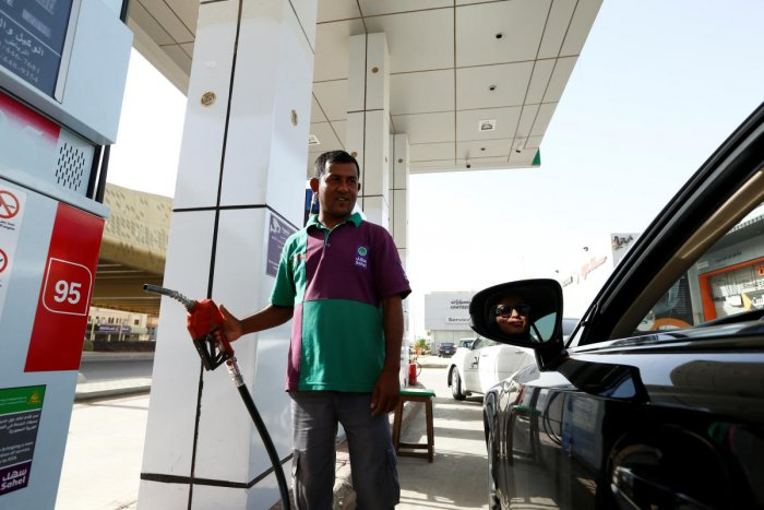 Majdooleen, who is among the first Saudi women allowed to drive in Saudi Arabia refuels her car as she going to work in Riyadh, Saudi Arabia on Sunday. REUTERS