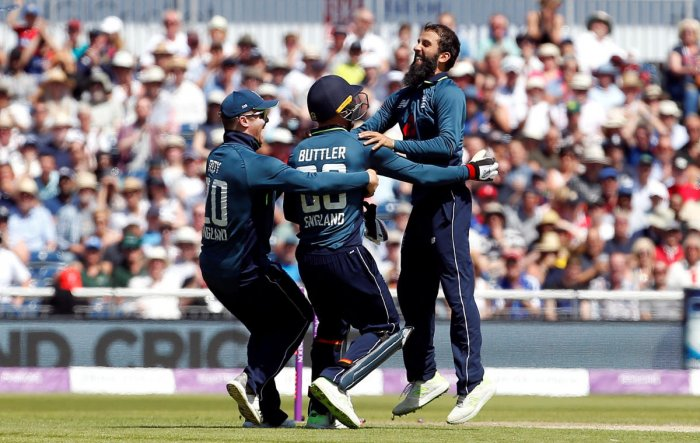 England's Moeen Ali (right) celebrates with team-mates after dismissing Australia's Tim Paine in the fifth and final ODI in Manchester on Sunday. Reuters