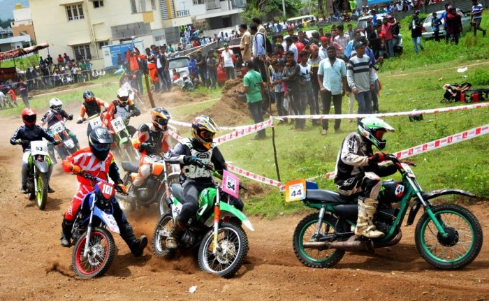 Participants take part in a dirt race on the bypass at Chikkamagaluru on Sunday.