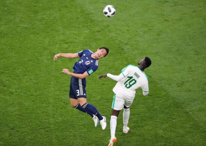 Soccer Football - World Cup - Group H - Japan vs Senegal - Ekaterinburg Arena, Yekaterinburg, Russia - June 24, 2018 Japan's Gen Shoji in action with Senegal's M'Baye Niang REUTERS
