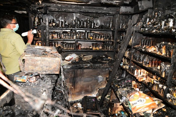 An official inspects the damage caused by the deadly fire in Kailash Bar and Restaurant, Kalasipalyam, on January 8, 2018. DH FILE PHOTO