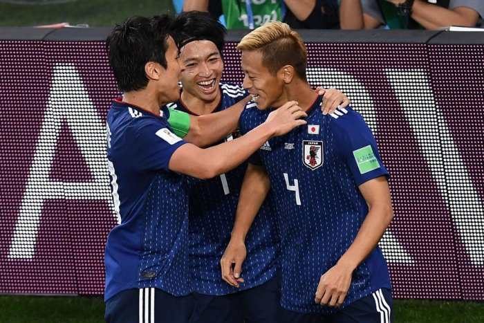 UNITED THEY DELIVER: Japan have played some adventurous football at this World to stand on the verge of entering the last-16 phase. AFP