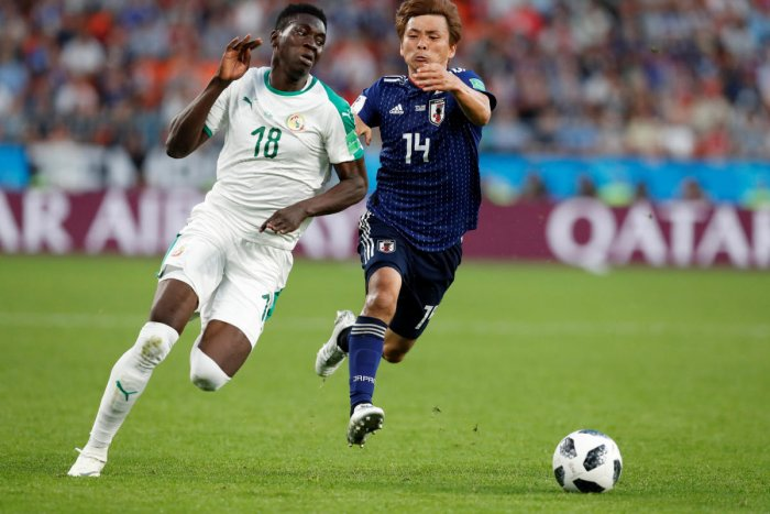 Soccer Football - World Cup - Group H - Japan vs Senegal - Ekaterinburg Arena, Yekaterinburg, Russia - June 24, 2018 Senegal's Ismaila Sarr in action with Japan's Takashi Inui REUTERS