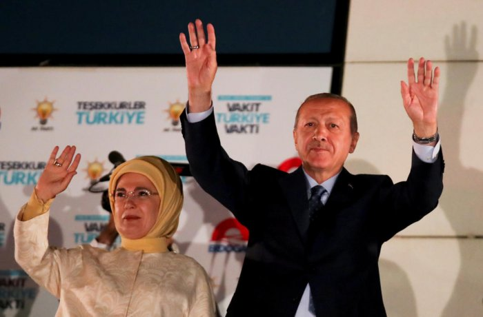 Turkish President Tayyip Erdogan and his wife Emine Erdogan greet supporters gathered in front of the AKP headquarters in Ankara, Turkey. REUTERS Photo