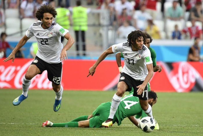 Saudi Arabia's midfielder Abdullah Otayf (bottom) falls while fighting for the ball with Egypt's midfielder Amr Warda (L) and midfielder Mohamed Elneny during the Russia 2018 World Cup Group A football match between Saudi Arabia and Egypt at the Volgograd