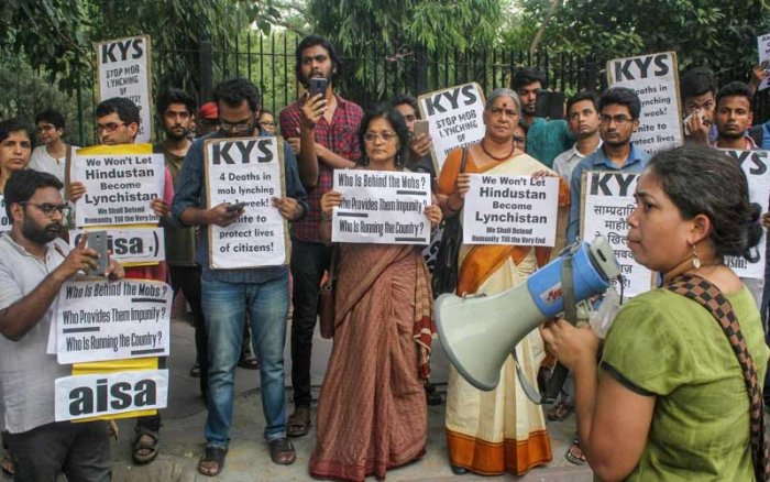 Family members of Md Kasim (45) who was lynched in Hapur allegedly over cow slaughter, with members of KYS and AISA stage a protest, at parliament street in New Delhi. (PTI Photo)