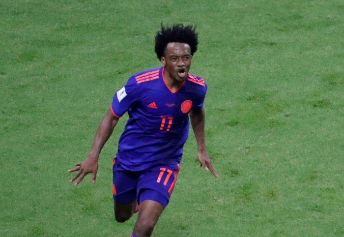 Colombia's Juan Cuadrado celebrates scoring their third goal. Reuters photo.