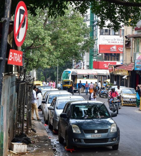 The proposal aims to declutter busy roads like Residency Road (above), lined with parked cars.