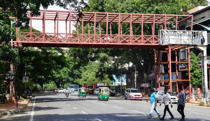 In an apparent attempt to avert a public backlash, the BBMP built a skywalk on Raja Ram Mohan Roy Road on Sunday night. dh photo/ANAND BAKSHI