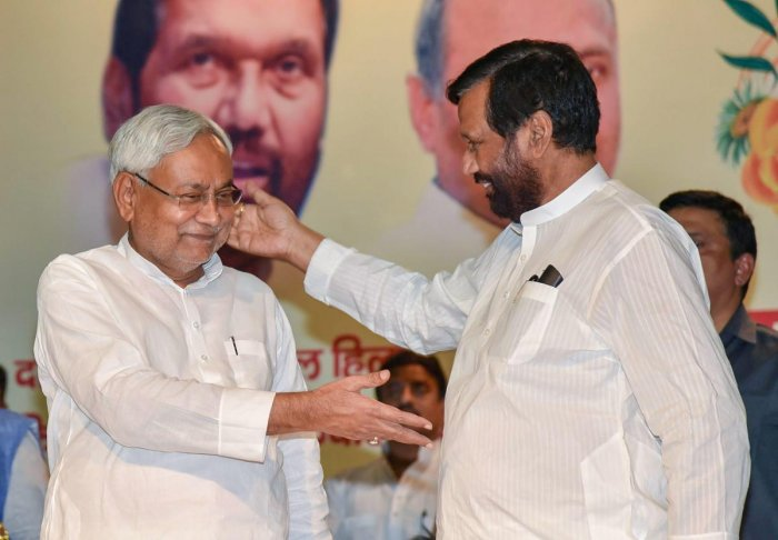 Bihar Chief Minister Nitish Kumar (left) with Lok Janshakti Party chief Ram Vilas Paswan during the birth anniversary of former prime minister V P Singh, in Patna on Monday. PTI