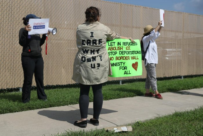 A woman protesting the detainment of undocumented immigrant children wears a jacket referencing Melania Trump during a demonstration outside a US Border Patrol processing center in McAllen, Texas. REUTERS Photo