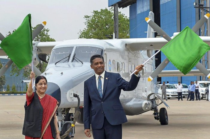 External Affairs Minister Sushma Swaraj and Seychelles President Danny Faure wave flags during the handing over ceremony of Dornier aircraft to Seychelles, at Palam Technical Area, in New Delhi on Tuesday. PTI