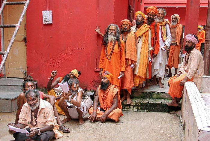 Sadhus wait in a queue for the registration for Amarnath Yatra, which commences on Wednesday, in Jammu on Tuesday. PTI
