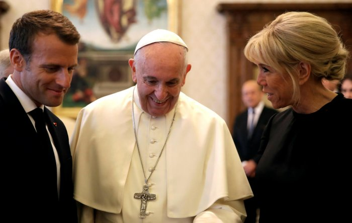 Pope Francis shares a word with French President Emmanuel Macron and his wife Brigitte during a private audience at the Vatican on June 26, 2018. Reuters