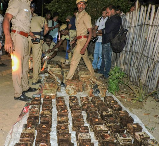 Police display the huge consignment of ammunition and explosives recovered near Thangachimadam, in Rameswaram on Monday evening. PTI