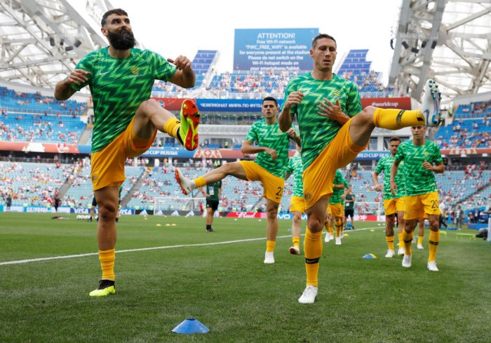 Australia's Mile Jedinak and Mark Milligan during the warm-up before the match REUTERS