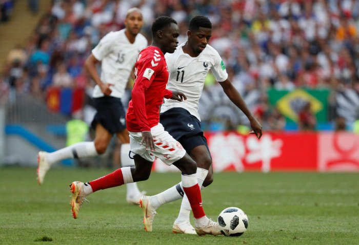 Denmark's Pione Sisto in action with France's Ousmane Dembele REUTERS