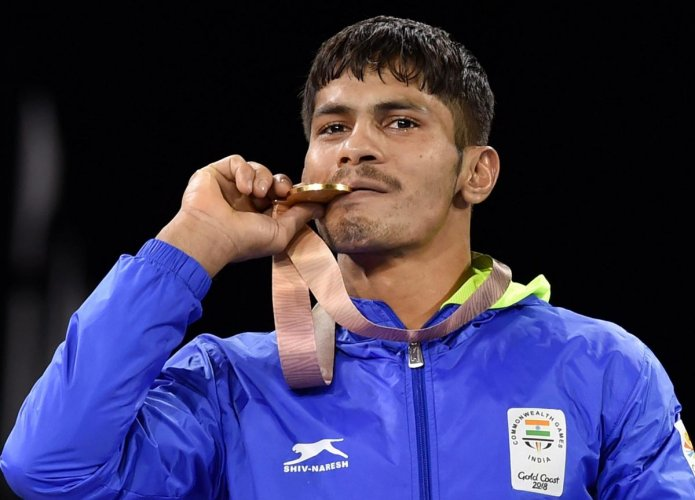 Gold medalist India's Rahul Aware during the medal ceremony of men's freestyle 57kg wrestling final at the Commonwealth Games 2018 in Gold Coast. (PTI Photo)