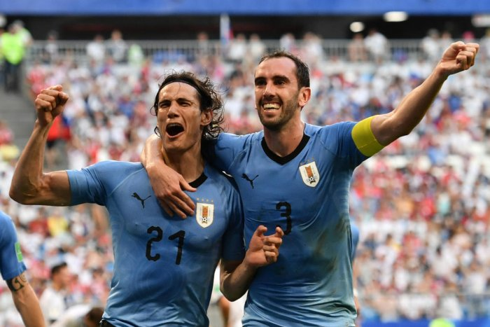 Uruguay's forward Edinson Cavani celebrates with Diego Godin (R) after scoring a goal during the Russia 2018 World Cup Group A football match between Uruguay and Russia at the Samara Arena in Samara. AFP