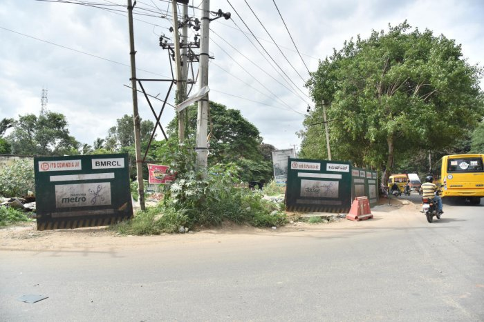 Land barricaded by BMRCL for its Metro corridor in Kadugodi. DH photo/Janardhan B K