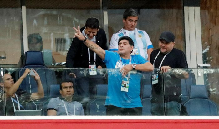 Diego Maradona gestures to the fans from the stands during the match. (REUTERS photo)