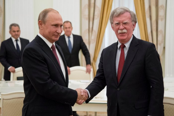 Russia's President Vladimir Putin shakes hands with US National Security Adviser John Bolton during a meeting at the Kremlin in Moscow, Russia June 27, 2018. Reuters