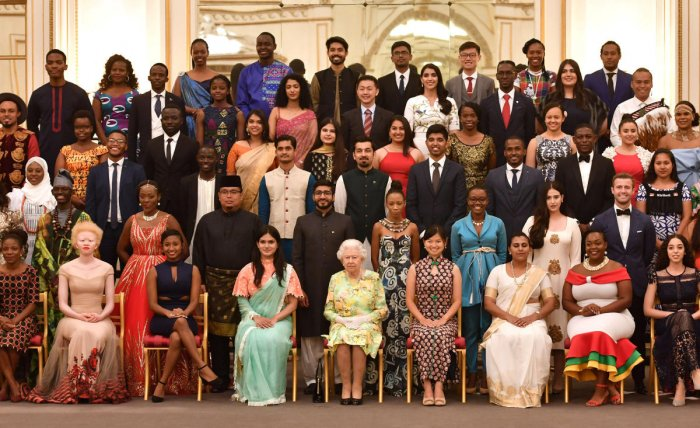 Britain's Queen Elizabeth poses for a picture with some of Queen's Young Leaders at a Buckingham Palace reception following the final Queen's Young Leaders Awards Ceremony, in London, Britain. Reuters Photo