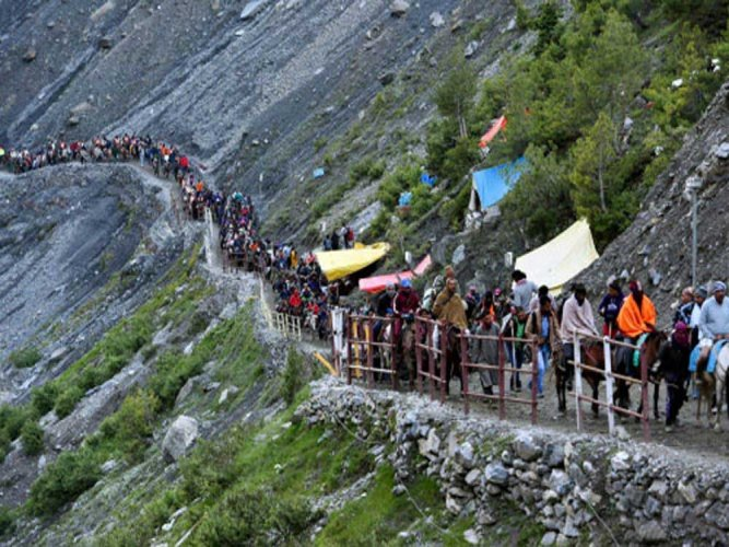 Amid tight security, the first batch of nearly 3,000 Amarnath pilgrims from Jammu reached the twin base camps at Baltal and Pahalgam in Kashmir on Wednesday evening. PTI file photo