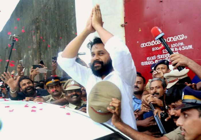 Actor Dileep being welcomed by a cheering crowd comprising his fans and friends as he comes out of Aluva sub-jail, in Kochi. (PTI Photo)