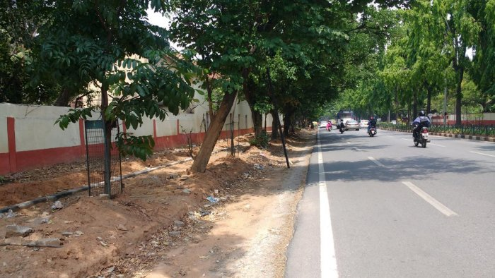 A footpath along Cubbon Road, reduced almost by half its original size to facilitate laying of the cycle track.