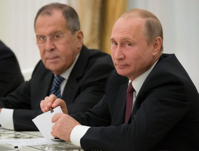 Russia's President Vladimir Putin (R) and Foreign Minister Sergei Lavrov attend a meeting with U.S. National Security Adviser John Bolton at the Kremlin in Moscow, Russia. (Reuters Photo)