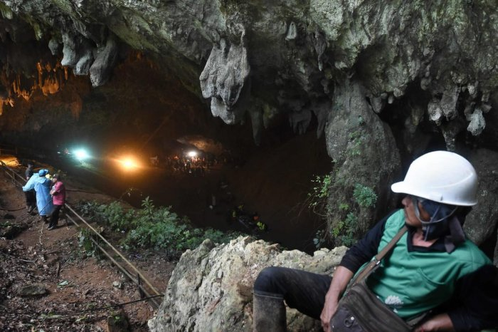 Rescue personnel are seen at the opening of the Tham Luang cave in Khun Nam Nang Non Forest Park, Thailand, during an operation to search for a missing children's football team and their coach. (AFP File Pic)