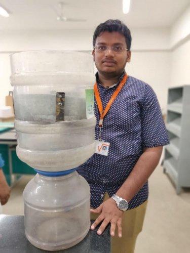 Pavan A demonstrates his model to purify Bellandur water.