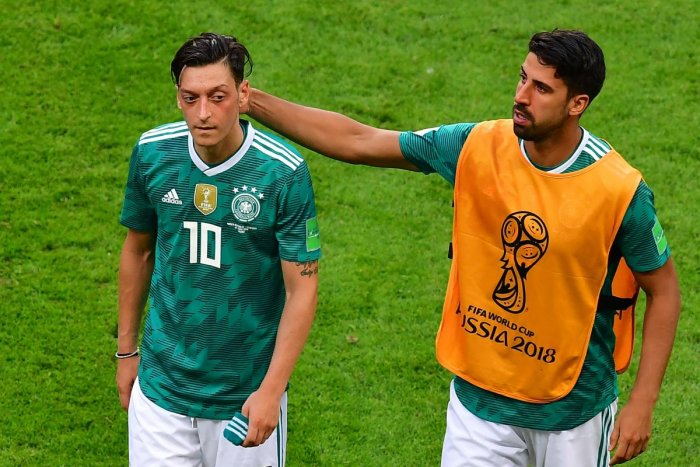 MULTIPLE PROBLEMS: Seasoned players like Mesut Ozil (left) and Sami Khedira failed to hit their high standards of old that contributed immensely to Germany's downfall at this World Cup. AFP