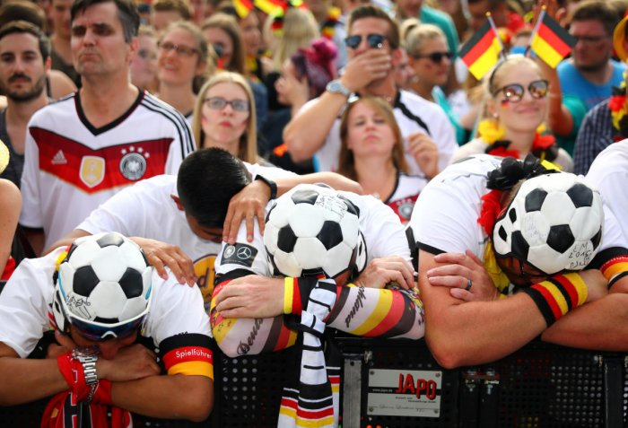 Germany fans react as they watch the match against South Korea at a public viewing area at Brandenburg Gate in Berlin. (Reuters Photo)
