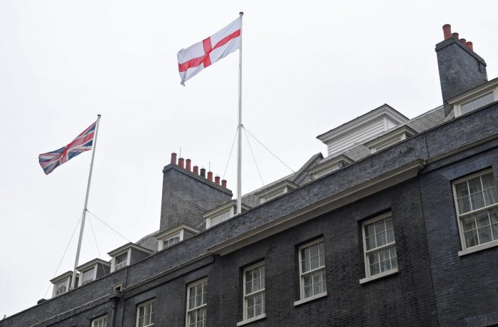 The St George's Flag flies above 10 Downing Street, ahead of England's game against Belgium in the World Cup on Thursday, in Westminster, London. (Reuters)
