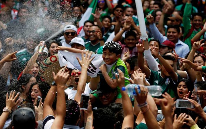 Mexican fans celebrate with a young South Korean citizen. (Reuters Photo)