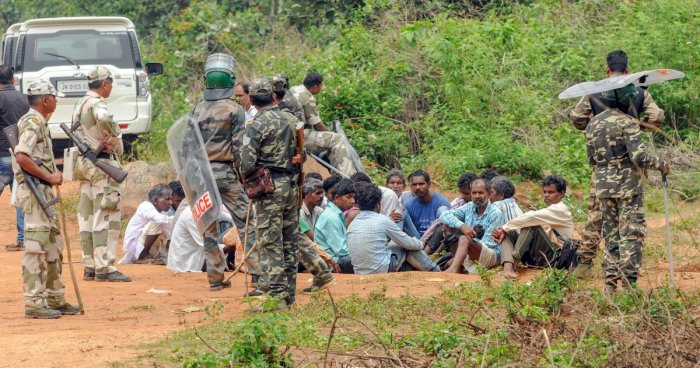 Security personnel detain villagers while carrying out a search operation at the remote village Ghagra, where Member of Parliament (MP) Karia Munda's three bodyguards, belonging to Jharkhand Police, were allegedly kidnapped by Pathalgarhi supporters.